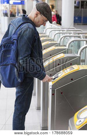 Utrecht Netherlands 15 march 2017: man with cap checks in on railway station utrecht centraal in Holland