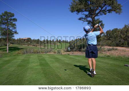 Young Golfer Hitting A Nice Tee Shot