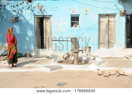 Woman In Front Of Her House At The Village Of Khajuraho