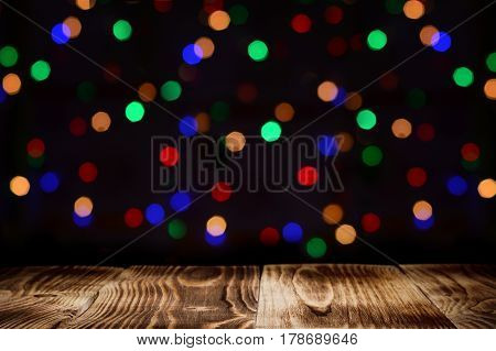 wood panels leading into the dark with bokeh lights