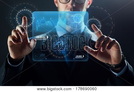 business, people, technology and statistics concept - close up of businessman in suit working with diagram chart on virtual screen over black background