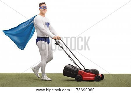 Full length portrait of a superhero mowing with a lawnmower and looking at the camera isolated on white background