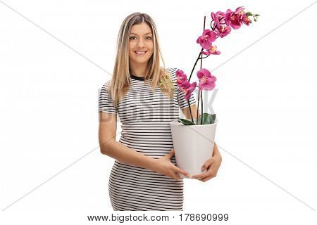 Young woman holding an orchid flower in a pot isolated on white background