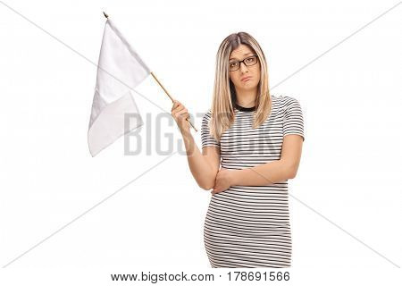 Sad young woman holding a white flag isolated on white background