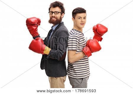 Man and teenage boy wearing boxing gloves and looking at the camera isolated on white background