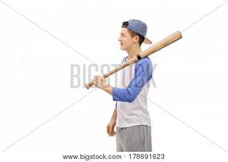 Profile shot of a teenager with a baseball bat and a cap isolated on white background