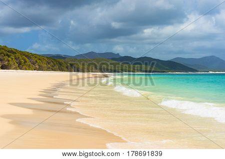 Beautiful Tropical Beach With White Foam Sea Wave
