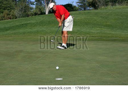 Man About To Make Putt, Focus On Golfer