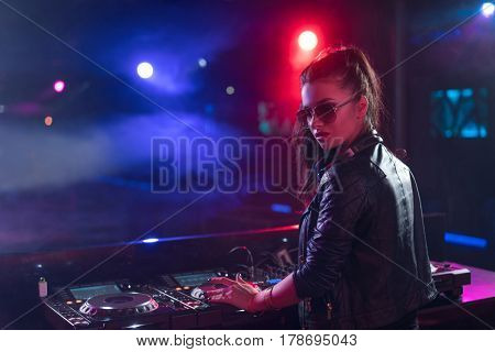 Young woman in a night club