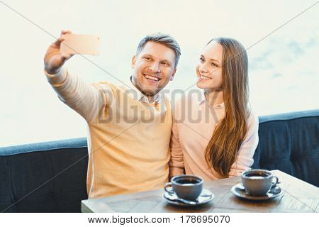 Young couple makes selfie indoors