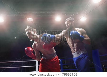 Active men in boxing ring