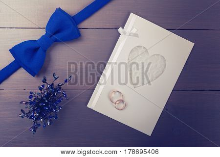 wedding accessories and rings on invitation card