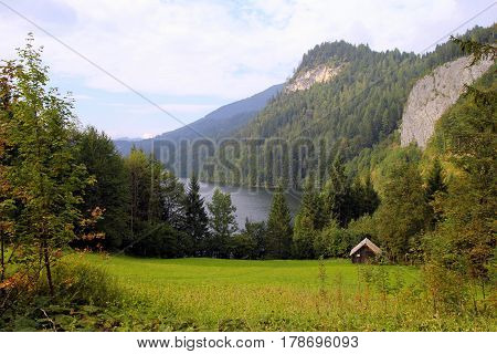 Travel To Sankt-wolfgang, Austria. The View On The On A Forest And A Meadow With A Lake And The Moun