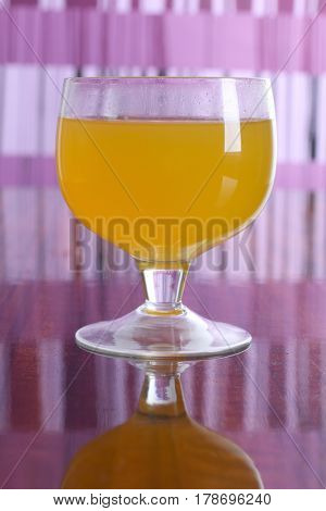 Cocktail in a glass on a colored background