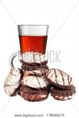 Sweet cookie and a cup of tea on white background