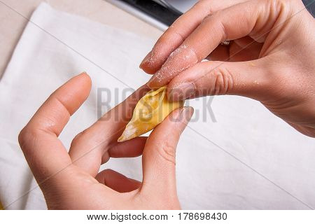 Woman's Hands With Dough Preparing Vareniki, Dumplings, Pierogi With Cottage Cheese Or Curd..