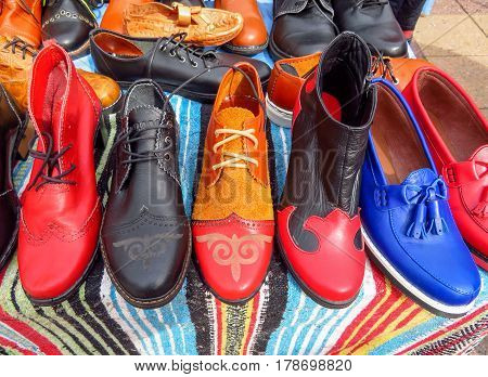 ALMATY KAZAKHSTAN - MARCH 26 2017: Ethnic colorful leather shoes with ornaments on the street market in Almaty Kazakhstan