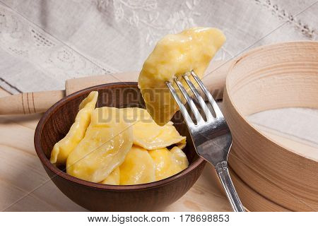 Close Up View Of Boiled Varenyky Or Dumpling With Cottage Cheese Or Curd On Metal Fork. Fresh Boiled