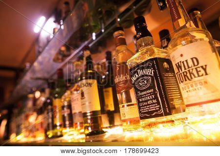 BUCHAREST ROMANIA - March 22 2017: Illustrative editorial image of some alcohol bottles in a row displayed in a pub or restaurant.