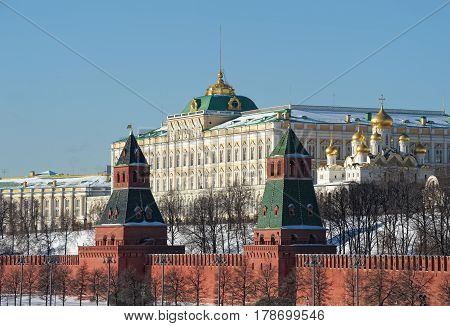 View of the Grand Kremlin Palace founded by Emperor Nicholas I was built in 1838-1849 years and towers of the Moscow Kremlin