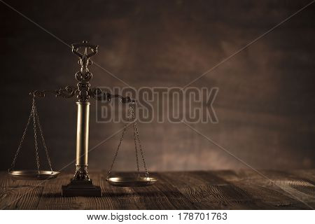 Law and justice concept - scale of justice  on wooden background
