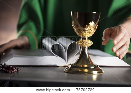 Catholic religion theme. Catholic priest during Holy Mass.