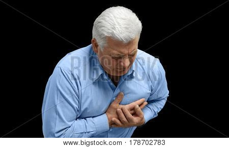 Man with chest pain suffering from heart attack on black background