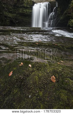 Stunning Watefall Landscape In Cross Over Between Autumn And Winter With Fall Colour