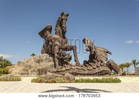 HALLANDALE BEACH USA - MAR 11 2017: Statue of Pegasus defeating a dragon in Gulfstream Park. Hallandale Beach Florida United States