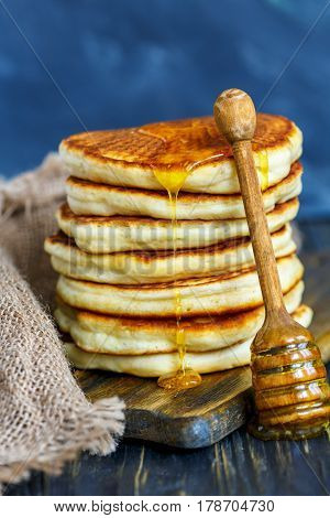 Stack Of Pancakes With Honey.