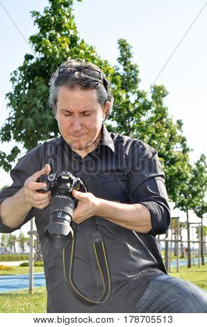 Photographer facial expressions while shooting and dslr camera
