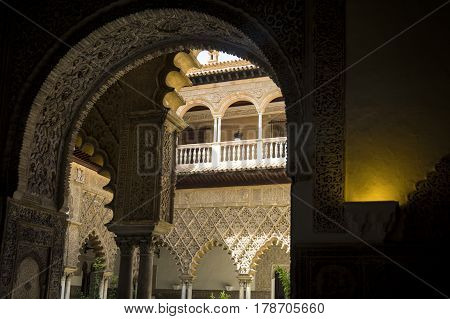Interior of the Alcazar of Seville framed by doorway