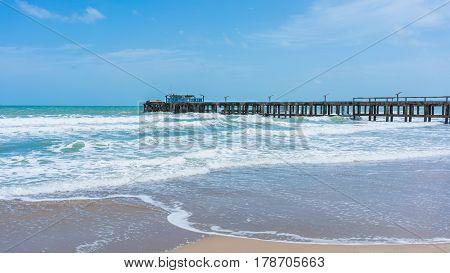 Pier in beautiful Mae Rumphueng Beach in Rayong , Thailand