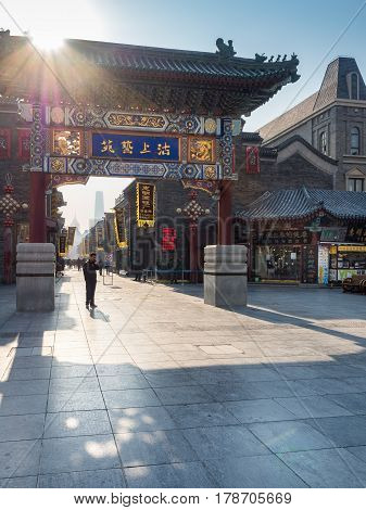 Tianjin, China - Nov 1, 2016: Main gate to the Tianjin Ancient Cultural Street. Morning scene to what is a very popular tourist area.