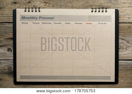 Monthly planner on the wooden table background