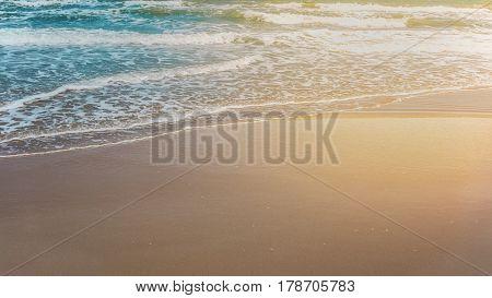 Waves at Mae Rumphueng Beach , Rayong , Thailand using split toning and increasing warm light