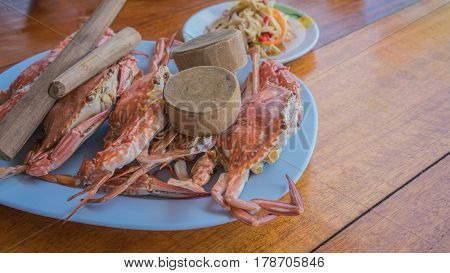 Fresh steamed crab with tools served in seafood restaurant at Mae Rumphueng Beach , Rayong , Thailand