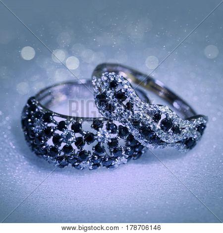 Luxury platinum rings with white and black diamonds