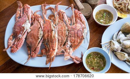 Fresh steamed crab with tools and spicy seafood sauce served in seafood restaurant at Mae Rumphueng Beach Rayong Thailand
