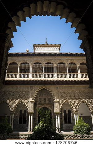 Alcazar of Seville framed by ornate doorway