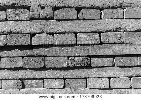 Wood railway beams track sleepers stacked closeup abstract black and white background textures detail.