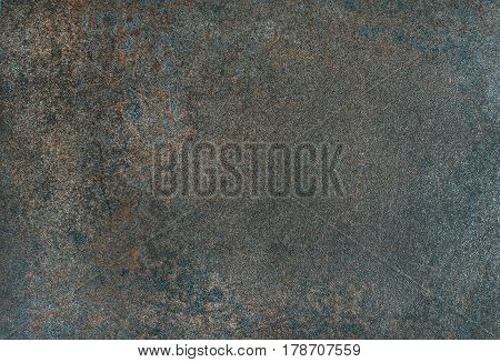 Copper colored natural stone texture, wallpaper and background. Stone formation with iron ore