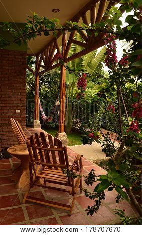 Cozy patio with chairs in the tropical garden