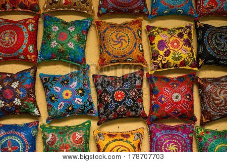 Colorful handmade uzbek cushions. Uzbek pillows Hung on the wall