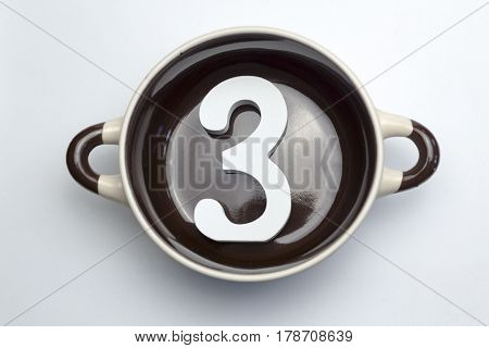 Figure three on the bottom of the soup tureen on white background.