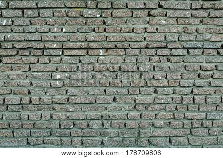 A wall made of layers of gray granite small