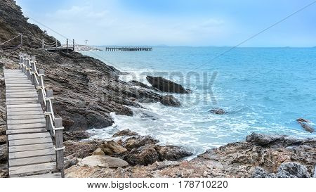 Wooden walkway along the coastline to peninsula at Khao Laem Ya National Park Rayong Thailand