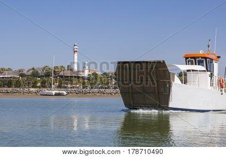 Ferry departs from El Rompido Marina. This little boat only for passengers cross Piedras River to get Atlantic Beach of La Flecha Cartaya Huelva Spain