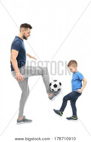Handsome man and his son playing football on white background