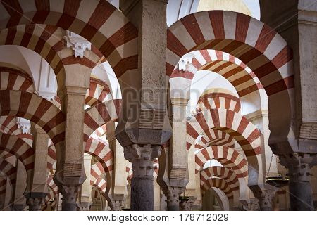 Red and white arches in mosque-cathedral of Cordoba in Andalusia